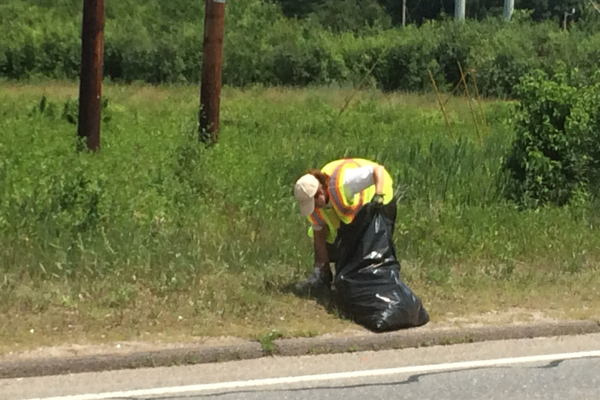 Paige Impink cleans up around Route 38.