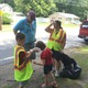 Former selectmen and current candidate for State Representative Doug Sears participated in the Town Cleanup Day. Here, he chats with Cheryl Barnes and her children.