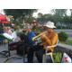 Arnie Rosen and Hiro Tokushigee play for a gathering of delighted diners at Cafe Sicilia.