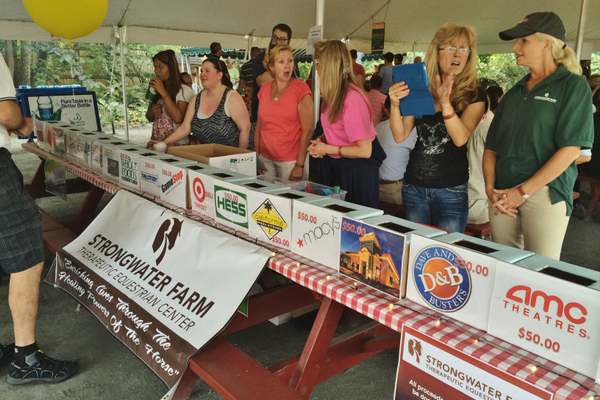 Thermo Fisher held a fund-raisng raffle at Kimball Farm for Strongwater Farm earlier this month and raised more than $6,000.
