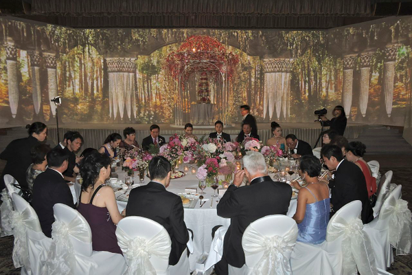 Head table sits for a gourmet dinner.